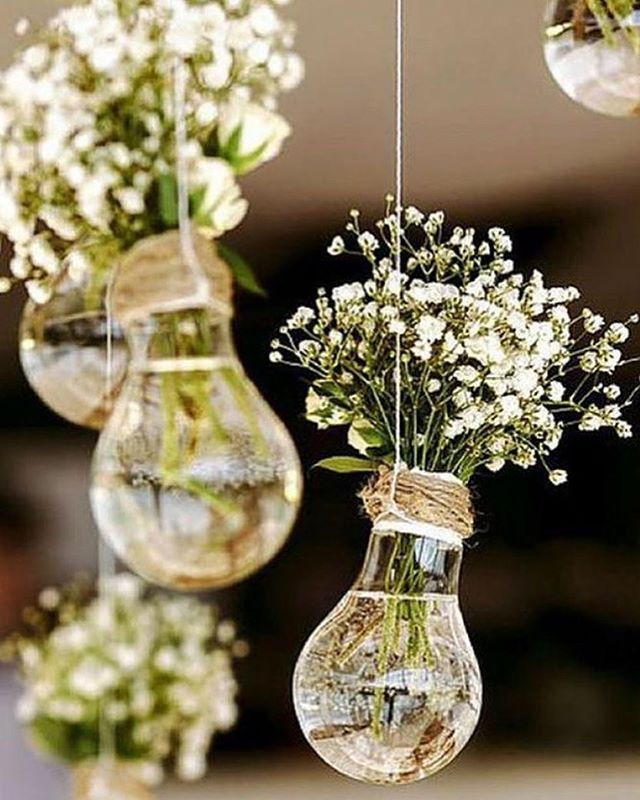 62 Spring Wedding Ideas We Can't Get Enough Of – flowers filled in light bulbs hanging